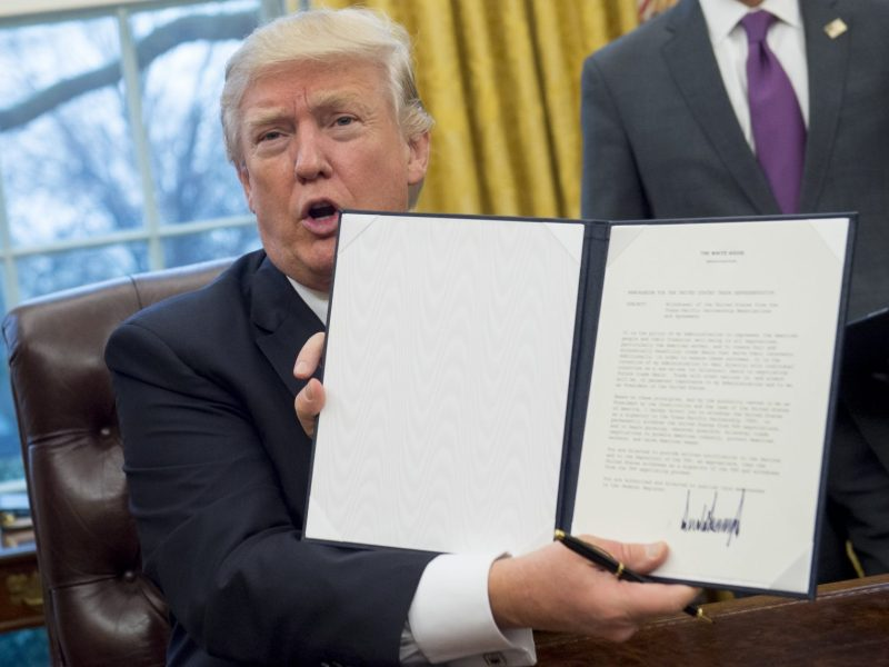 US President Donald Trump holds up an executive order withdrawing the US from the Trans-Pacific Partnership in January 2017. Photo: AFP/Saul Loeb