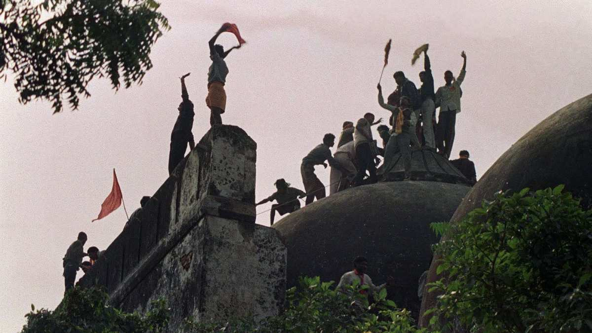 Hindu activists atop the 16th-century Babri Masjid in Ayodhya during its demolition in 1992. Photo: AFP