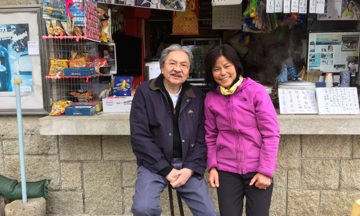 A photo of Aunt Lin with John Tsang in front of the Tai Mo Shan Kiosk. Photo: Facebook