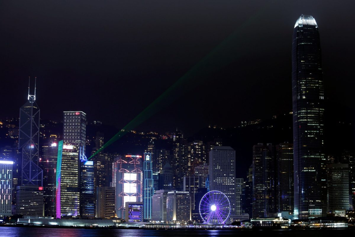 Laser light beams on buildings in the financial district of Central. Photo: Reuters/Bobby Yip