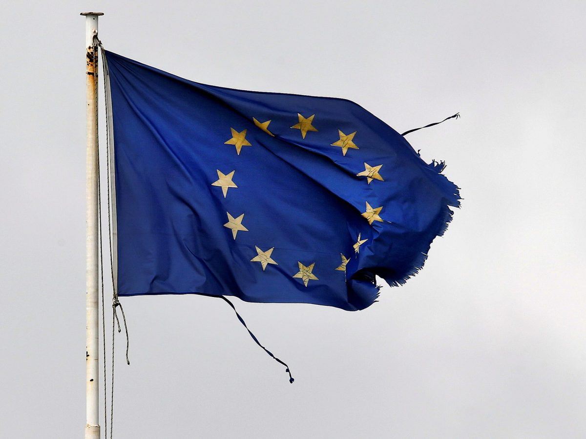 A frayed EU flag flutters atop the Greek Ministry of Finance in central Athens, Greece. Photo: Reuters