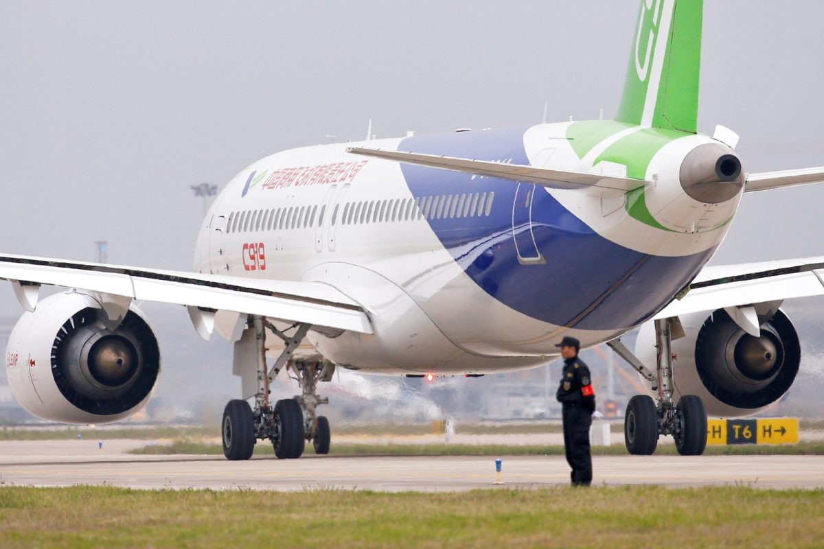 China's home-grown C919 passenger jet at Pudong International Airport before its maiden flight. Photo: Reuters, Aly Song