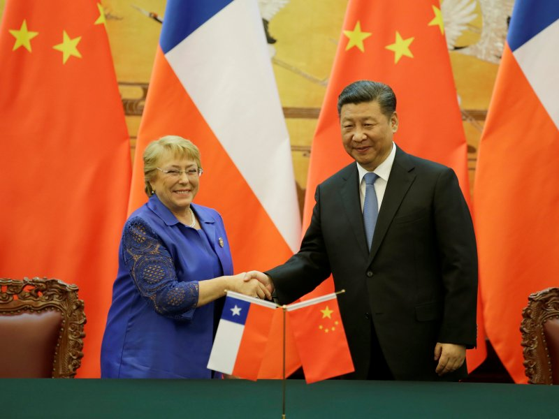 Chilean President Michelle Bachelet (L) and Chinese President Xi Jinping attend a signing ceremony ahead of the Belt and Road Forum in Beijing, China May 13, 2017. Photo: Reuters/Jason Lee