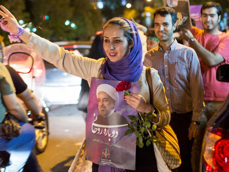 A woman holds a poster of Iranian President Hassan Rouhani during a campaign rally in Tehran, Iran, May 17, 2017. Photo: Reuters