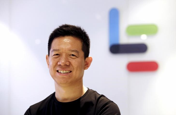 Jia Yueting, co-founder and head of Le Holdings Co Ltd, also known as LeEco and formerly as LeTV, poses in front of a logo of his company in Beijing. Photo: Reuters/Jason Lee