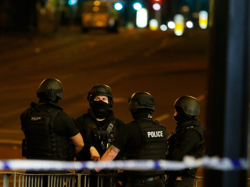 Armed police officers stand near the Manchester Arena, where American singer Ariana Grande had been performing. Photo: Reuters / Andrew Yates