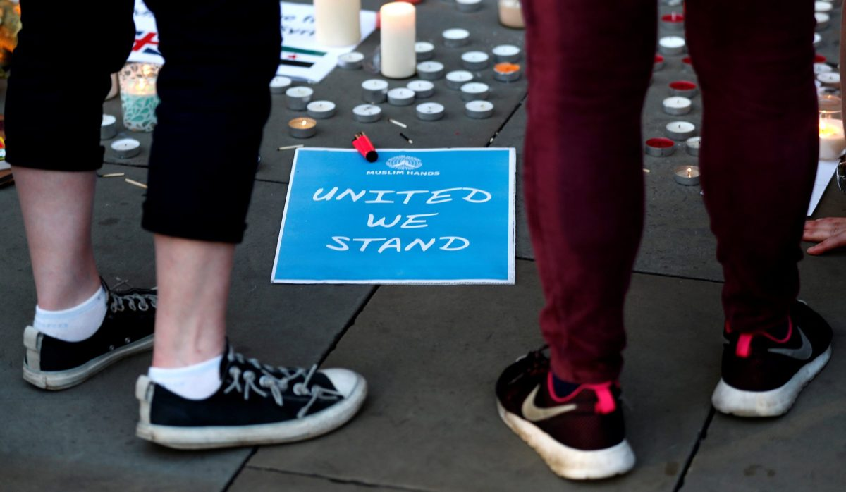 Well-wishers pay their respects to all those affected by the bomb attack, following a vigil in central Manchester. Photo: Reuters/Peter Nicholls