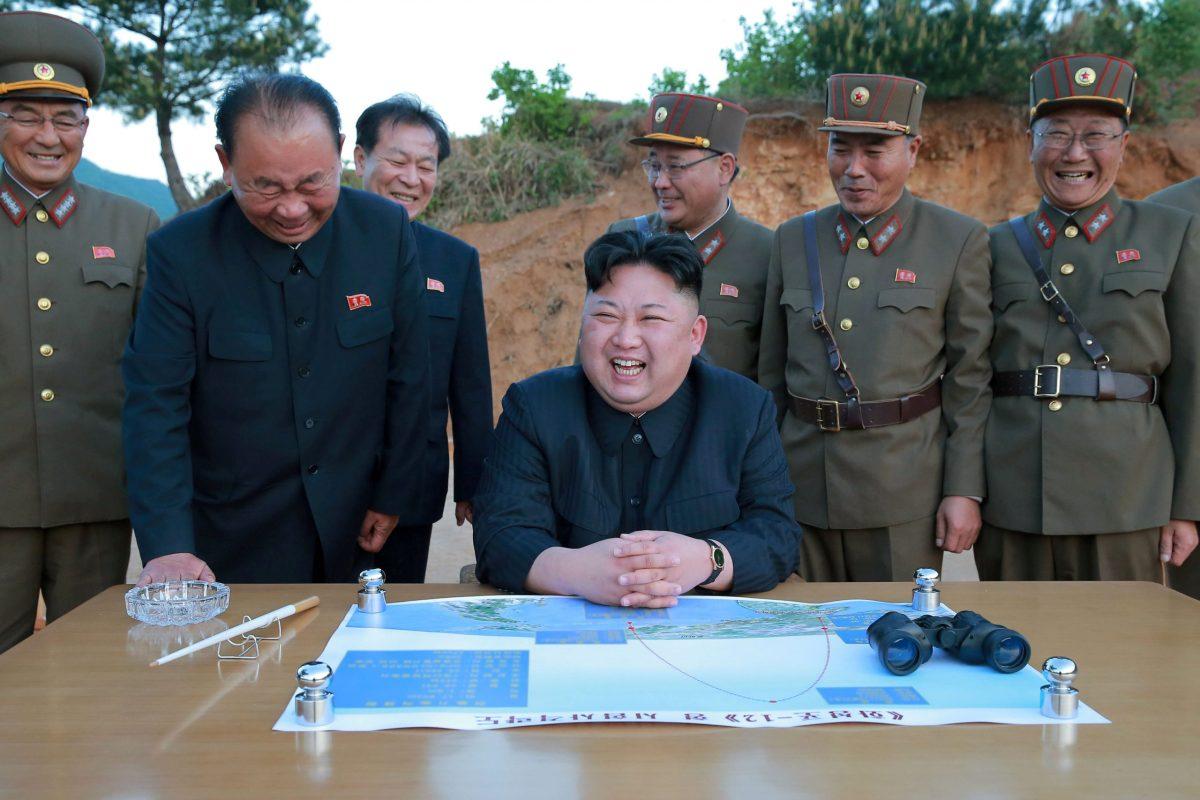 North Korean leader Kim Jong-un reacts during the long-range strategic ballistic rocket Hwasong-12 (Mars-12) test launch with Ri Pyong-chol (second left), Kim Jong-sik (center) and Jang Chang-ha (second right). Photo: KCNA via Reuters