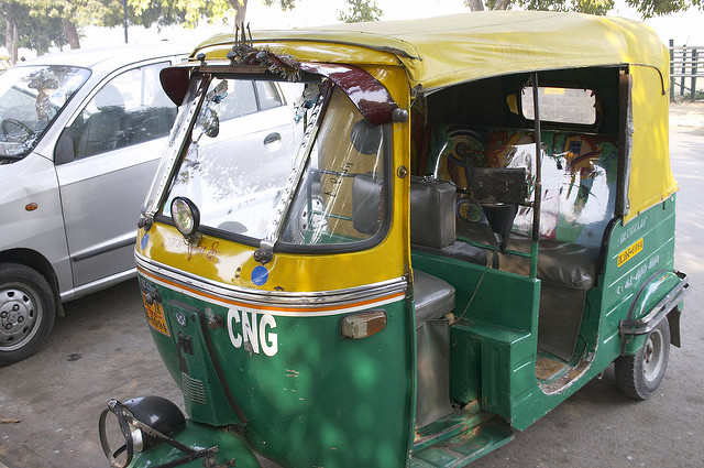 An autorickshaw driver is giving commuters a financial break to show his affection for the prime minister. Photo: Flickr
