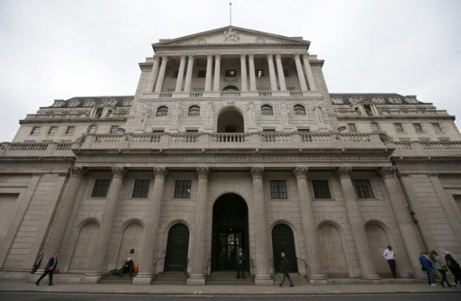 Pedestrians walk past the main entrance to the The Bank of England in the City of London. Photo: AFP/Daniel Leal-Olivas