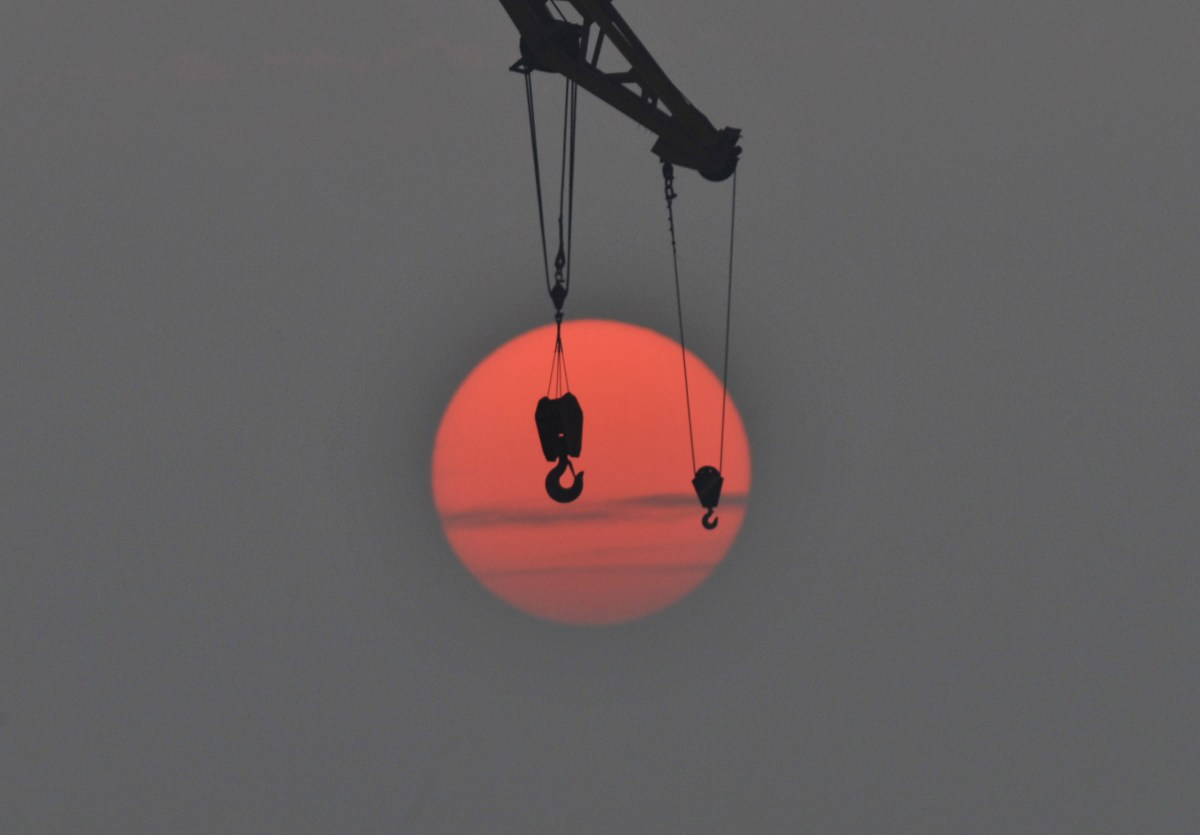 The hooks of a crane at a port in Qingdao, Shandong province, China, October 14, 2015. Photo: Reuters/China Daily
