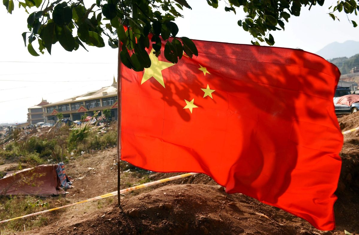 A Chinese national flag flutters on the borderline of China's Yunnan and Myanmar's Kokang region in Nansan town, Lincang city, southwest China's Yunnan province. Photo: AFP Forum
