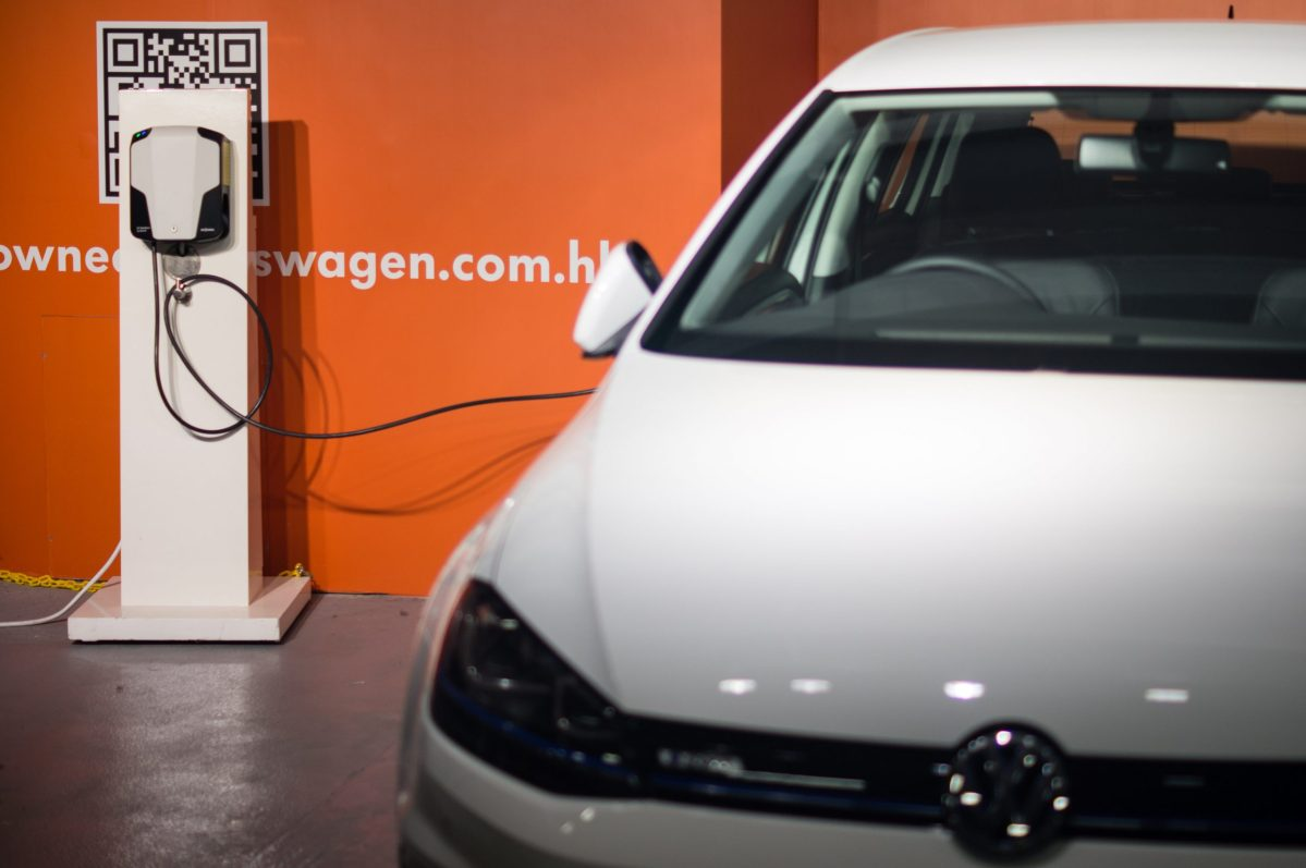 An electric car is charging in a parking lot in Kowloon Bay, Hong Kong. Photo: Asia Times/Lin Wanxia
