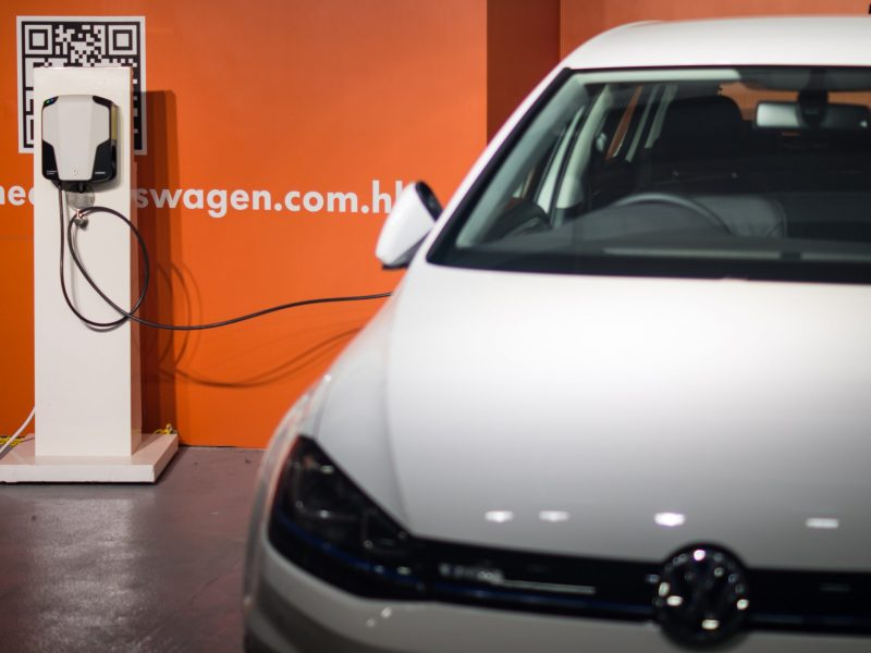 An electric car is charging in a parking lot in Kowloon Bay, Hong Kong. Photo: Asia Times/Lin Wanxia