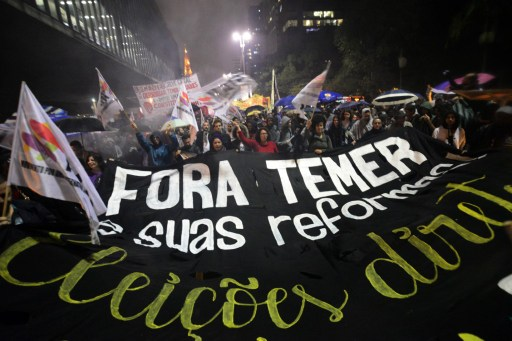 Demonstrators protest against Brazilian President Michel Temer in Sao Paulo, Brazil. Photo: AFP