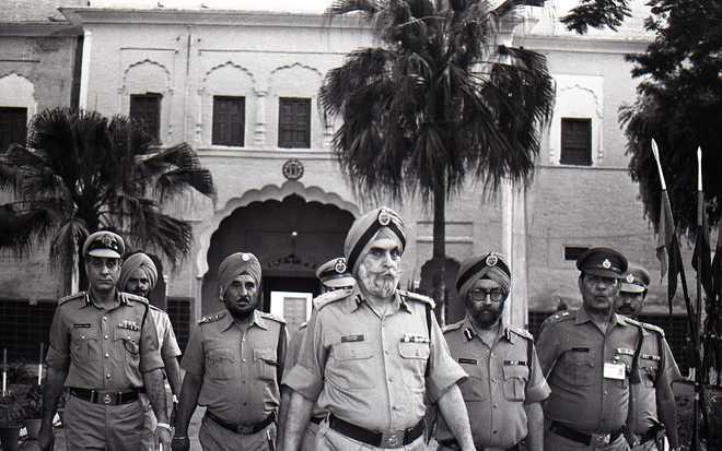 Kanwar Pal Singh Gill, center, at the Punjab police training center in Bahadurgarh. Photo: The Tribune