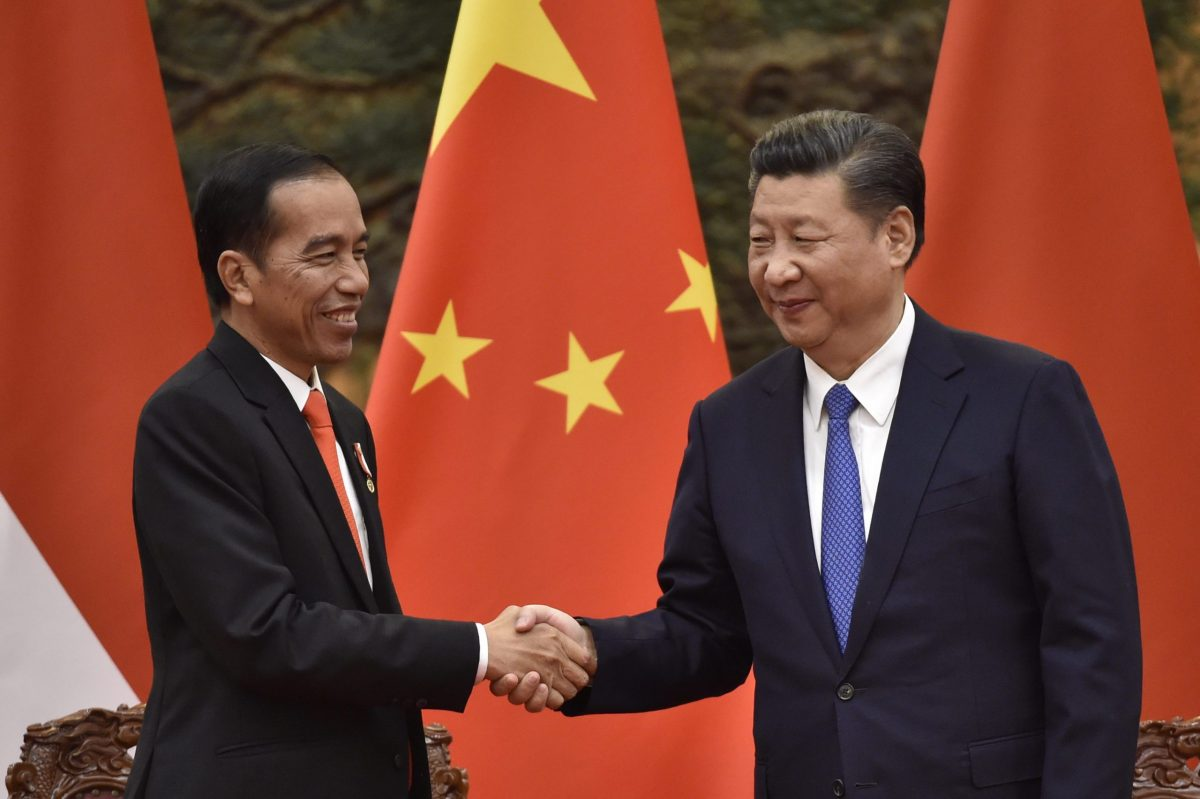 Indonesia's President Joko Widodo (L) and Chinese President Xi Jinping shake hands at the end of signing ceremony at the Great Hall of People in Beijing on May 14, 2017. Photo: AFP/ Kenzaburo Fukuhara