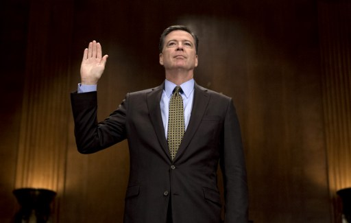 Former FBI Director James Comey sworn in prior to testifying before the Senate Judiciary Committee on Capitol Hill.  Photo: AFP, Jim Watson