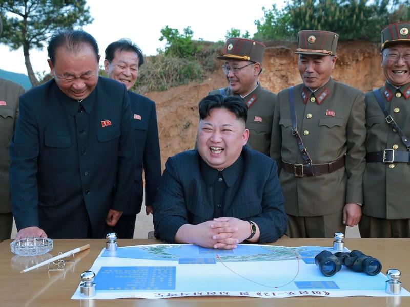 North Korean leader Kim Jong Un reacts during the launch of a long-range strategic ballistic rocket. Photo: Reuters