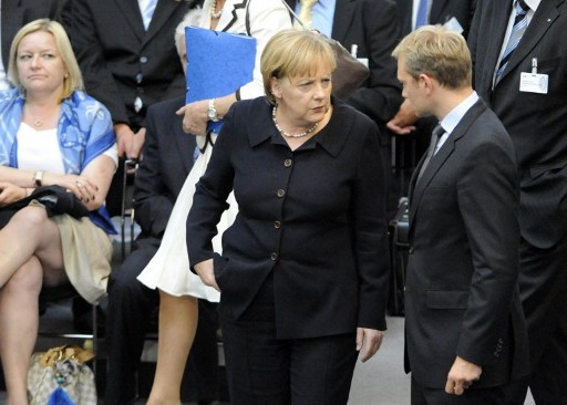 German Chancellor Angela Merkel talks with Free Democratic Party chief Christian Lindner at the Bundestag in Berlin. Photo: AFP: Barbara Sax