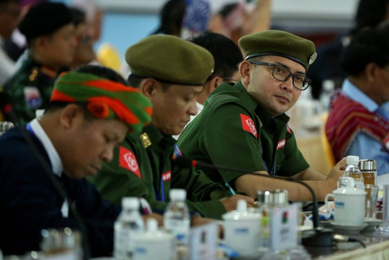 Leaders of the Arakan Army, ethnic rebel group, gather with other rebel leaders and representatives of various Myanmar ethnic rebel groups at the opening of a four-day conference in Mai Ja Yang, a town controlled by the Kachin Independence Army (KIA) in northern Kachin State on July 26, 2016.The conference is organized by the rebel leaders ahead of the August planned peace conference by Aung San Suu Kyi's new civilian-led government. Suu Kyi has made peace a flagship policy of her new government, which took over in March after decades of brutal junta rule while conflicts continue to rage in several areas between ethnic minority armed groups and the army. Some 240,000 people have been displaced nationwide due to unrest and communal conflict. / AFP PHOTO / STR