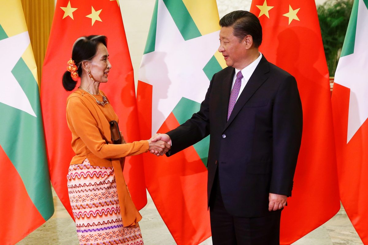 Myanmar State Counsellor Aung San Suu Kyi shakes hands with Chinese President Xi Jinping as they meet at the Great Hall of the People in Beijing, China, May 16, 2017.   Photo: Reuters/Damir Sagolj