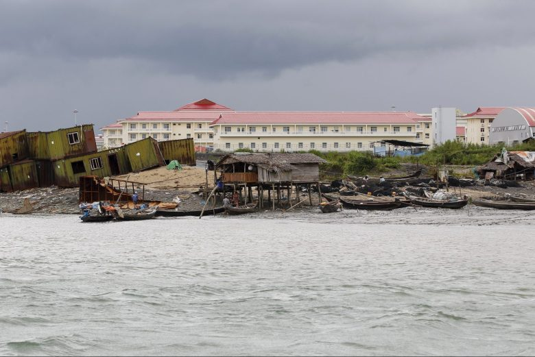 Local residents' houses in front of buildings of a Chinese oil pipeline project (pink roof) on Madae island, Kyaukpyu township, Rakhine state, Myanmar. The wider project, part of China's One Belt, One Road initiative, envisions twin oil and gas pipelines, a deep sea port and special economic zone. Photo: Reuters/Soe Zeya Tun