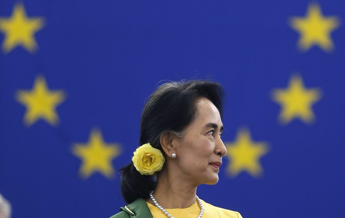 Myanmar pro-democracy leader Aung San Suu Kyi attends an award ceremony to receive her 1990 Sakharov Prize at the European Parliament in Strasbourg, October 22, 2013. The European Parliament awarded its top human rights prize in 1990 to Suu Kyi, who was then not allowed to leave her country to attend the ceremony. REUTERS/Vincent Kessler (FRANCE - Tags: POLITICS) - RTX14JJP