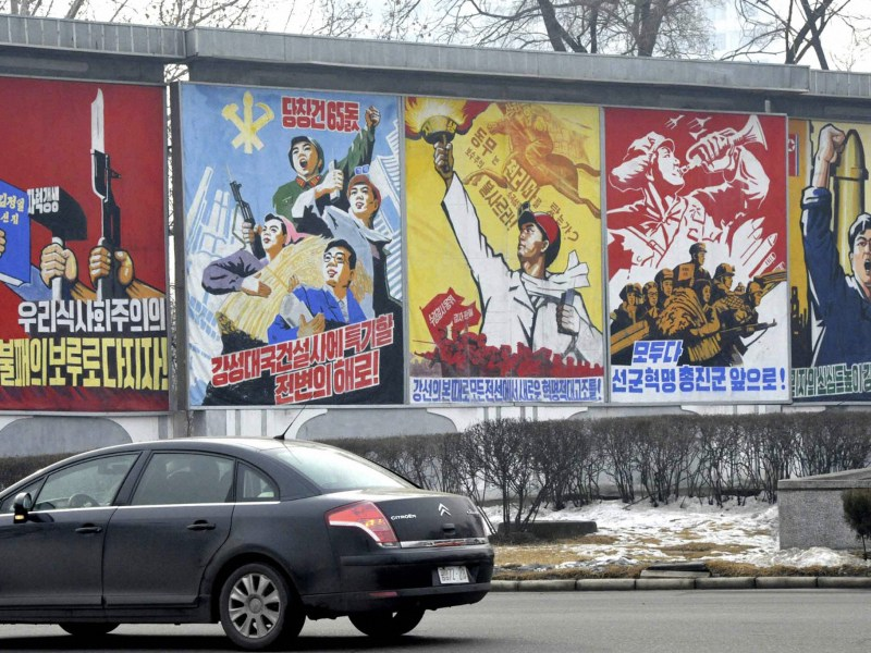 Propaganda billboards hailing economic projects and the military in Pyongyang December 21, 2010. REUTERS/Kyodo