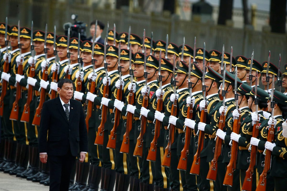 Philippine President Rodrigo Duterte and Chinese President Xi Jinping (not pictured) review the guard of honor as they attend a welcoming ceremony at the Great Hall of the People in Beijing. Photo: Reuters/Thomas Peter