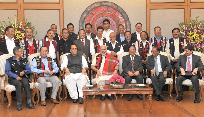 Indian Prime Minister Narendra Modi (seated center) at the signing of the Nagaland peace accord in 2015. Photo: Wikimedia Commons