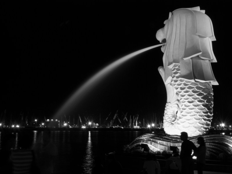 Water pours out from the mouth of the landmark Merlion in Singapore's opulent Marina Bay. Photo: iStock/Getty Images