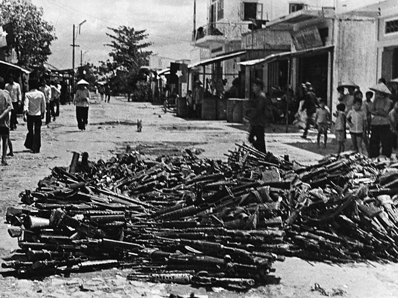 (VIETNAM-25, 1/3)A 01 May 1975 photo shows a large pile of US-made rifles abandoned by pro-American Southern Vietnamese army soldiers collected at Nhan Nghia commune, Chau Thanh district, in the southern province of Can Tho one day after Saigon fell to communist troops. Few young Vietnamese express much interest in the war, even though it scarred the lives of the parents and grandparents. AFP PHOTO / AFP PHOTO / VIETNAM NEWS AGENCY
