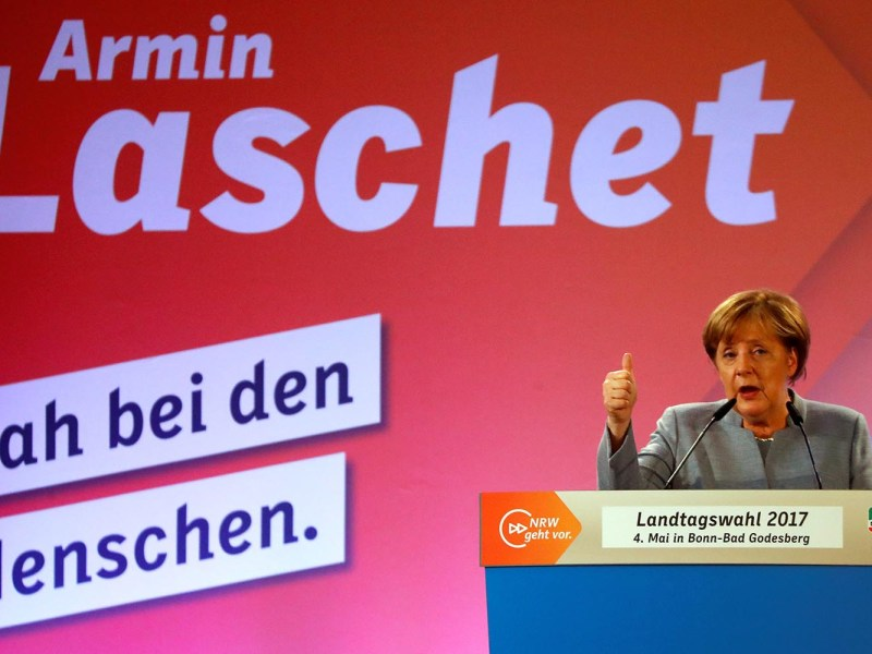 Victory for German Chancellor Angela Merkel may have a soothing effect on the market. Photo: Reuters/Wolfgang Rattay