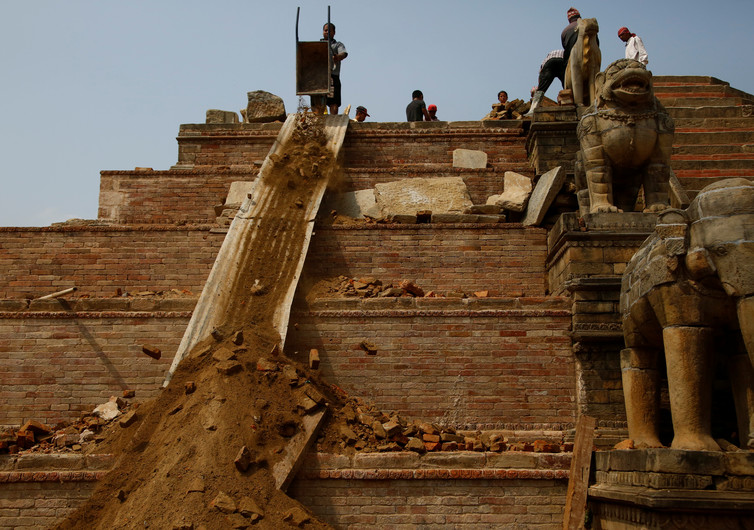 Workers rebuild a temple damaged during the 2015 earthquake, in Bhaktapur. Photo: Reuters/Navesh Chitrakar