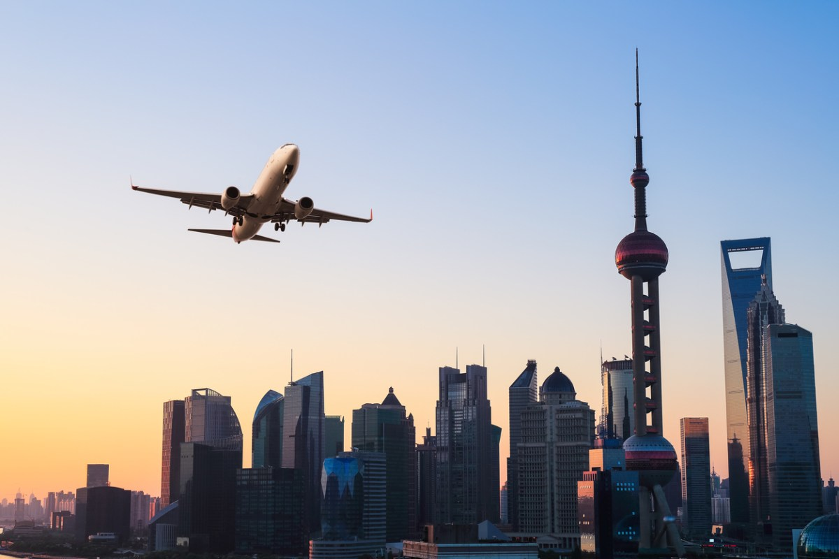 A plane flies over Shanghai. Photo: iStock