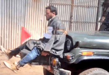 Kashmiri youth Farooq Ahmad Dar, tied to the front of a car, is used as a human shield by Army Major Leetul Gogoi. Photo: Times of India