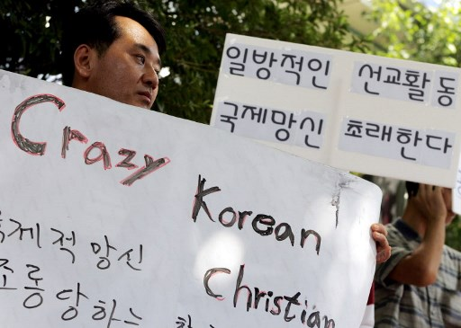 South Korean protestors hold placards during a protest against Saem-Mul Presbyterian church that sent 23 missionaries to Afghanistan in 2007.  Photo: AFP / Choi Won-suk