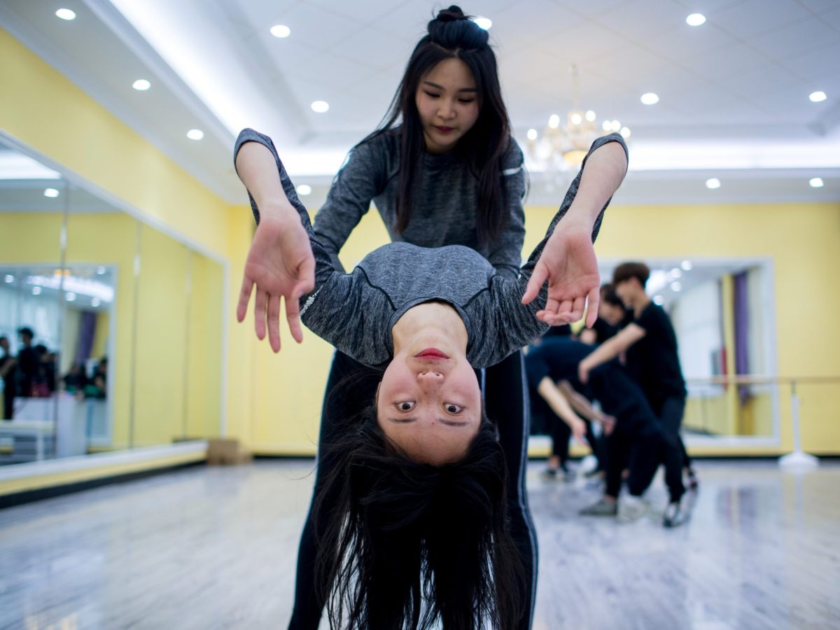 Wang Xin (top) attending a dance class at the Yiwu Industrial & Commercial College in Yiwu, east China's Zhejiang Province.  Hordes of Chinese millennials are speaking directly to the country's 700 million smartphone users. Photo: AFP/ Johannes Eisele