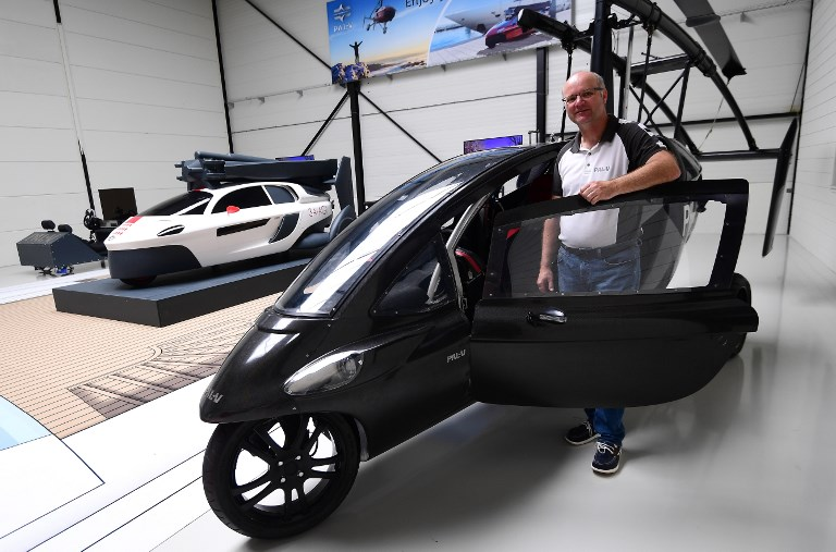 Chief Marketing Officer Markus Hess of the Dutch flying car developer PAL-V, poses next to one of the company's prototypes. Photo: AFP/Emmanual Dunand