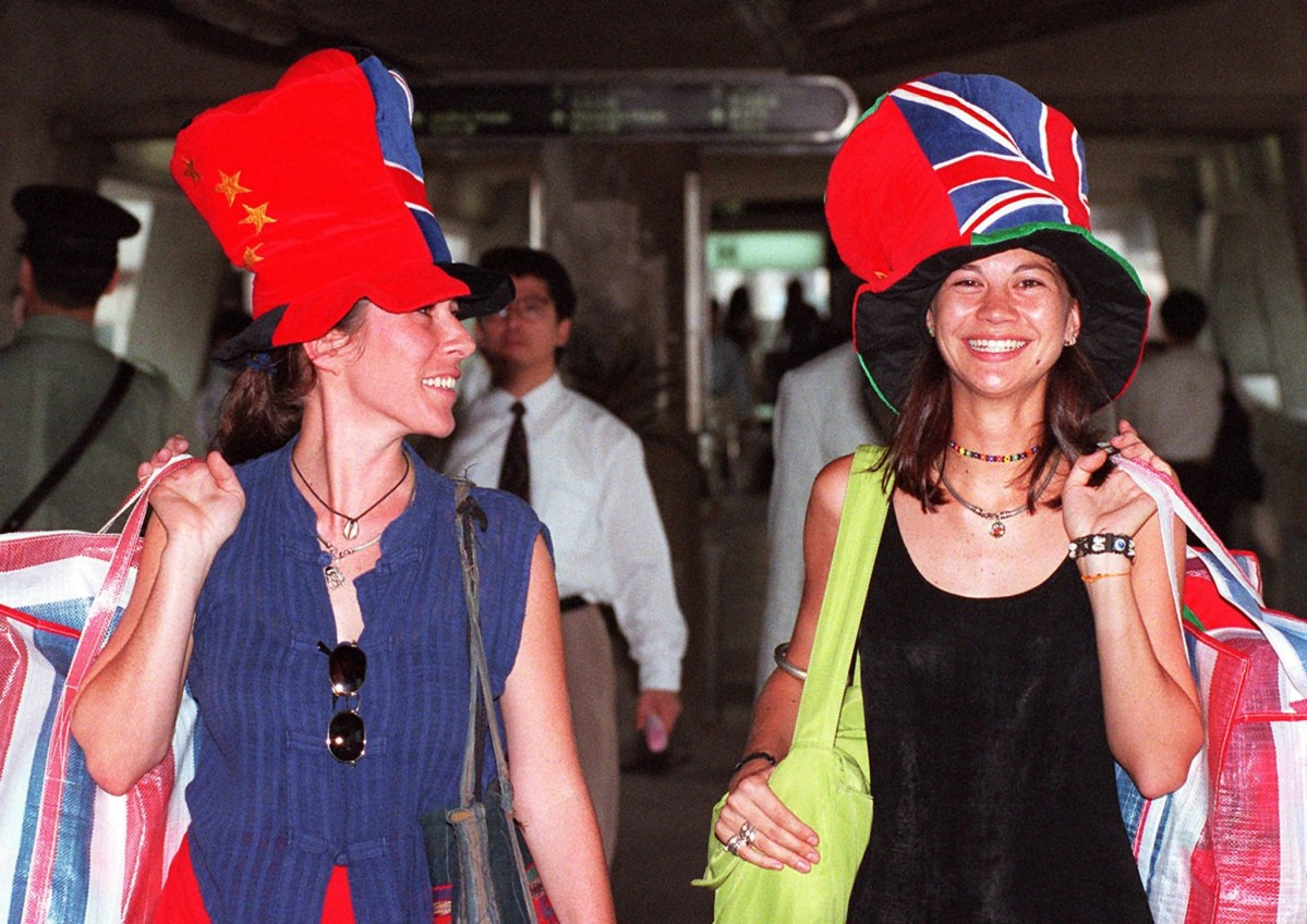 """Hong Kong Handover Hats,"" featuring Chinese and British flags, in Hong Kong's Central district, on 27 June, 1997. Photo: AFP / Torsten Blackwood"