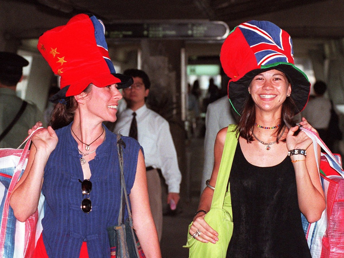 """""""Hong Kong Handover Hats,"""" featuring Chinese and British flags, in Hong Kong's Central district, on 27 June, 1997. Photo: AFP / Torsten Blackwood"""