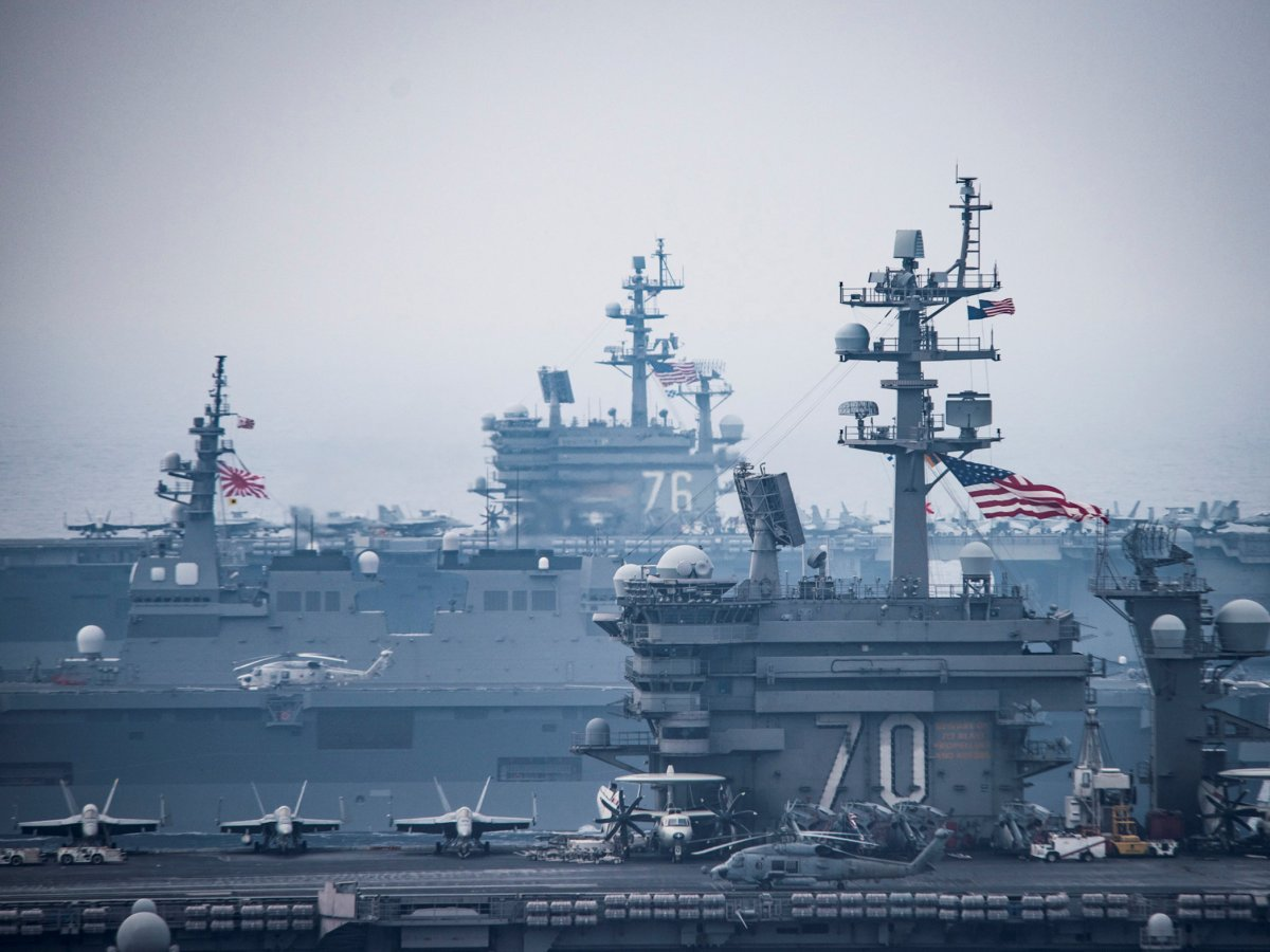 Japanese navy vessels sail with U.S. Navy aircraft carriers USS Carl Vinson (R) and USS Ronald Reagan during training in the Sea of Japan, June 1, 2017. U.S. Navy/Mass Communication Specialist 2nd Class Z.A. Landers/Handout via REUTERS