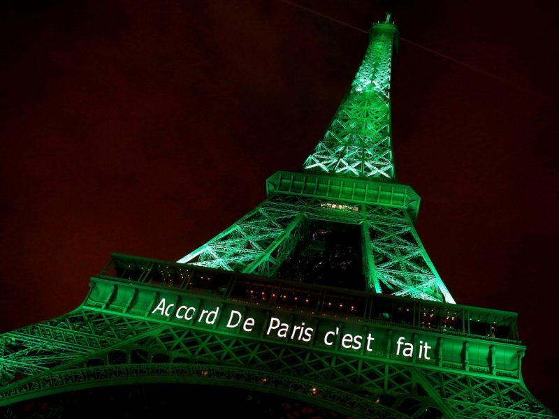 "The Eiffel Tower is illuminated in green with the words ""Paris Agreement is Done,"" to celebrate the UN COP21 Climate Change deal. Photo: Reuters / Jacky Naegelen"