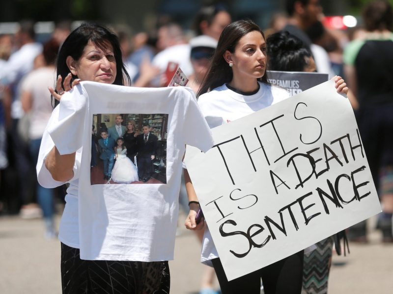 Chaldean-Americans protest against the seizure of family members on Sunday by Immigration and Customs Enforcement agents during a rally outside the Mother of God Chaldean church in Southfield, Michigan. Photo: Reuters/Rebecca Cook