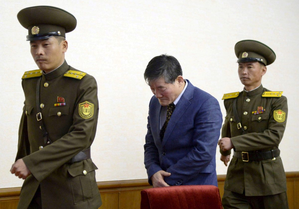 FILE PHOTO - A man (C) who identified himself as Kim Dong Chul, previously said he was a naturalised American citizen and was arrested in North Korea in October, leaves after a news conference in Pyongyang, North Korea, in this photo released by Kyodo March 25, 2016.   REUTERS/Kyodo/File Photo  ATTENTION EDITORS - THIS IMAGE WAS PROVIDED BY A THIRD PARTY.    MANDATORY CREDIT JAPAN OUT. NO COMMERCIAL OR EDITORIAL SALES IN JAPAN