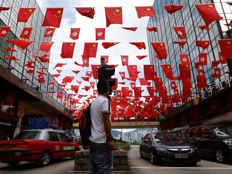 Chinese and Hong Kong flags are seen ahead of 20th anniversary of the handover from Britain to China in Hong Kong. Photo: Reuters/Tyrone Siu