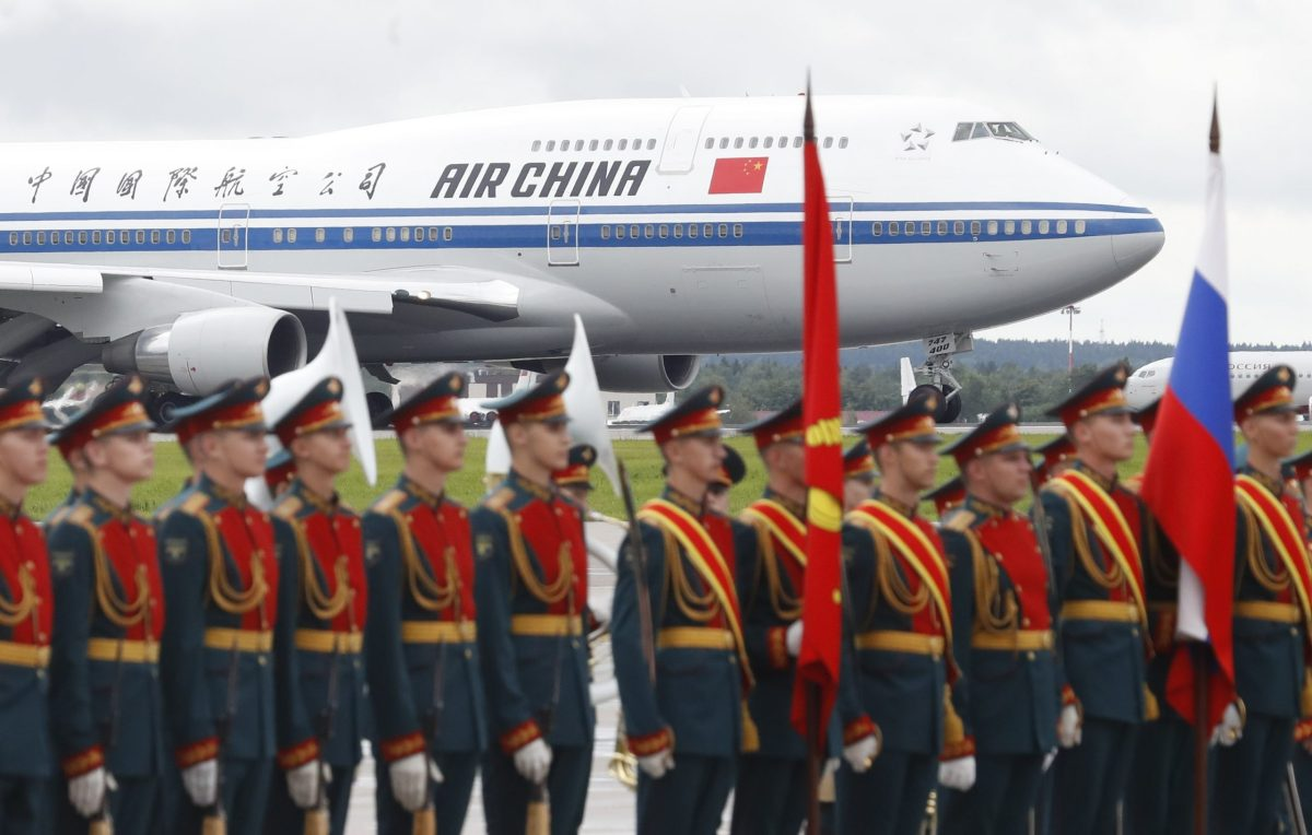 A plane with Chinese President Xi Jinping onboard drives along the tarmac shortly after the landing, with Russian honour guards seen in the foreground, at Moscow's Vnukovo airport, Russia July 3, 2017. REUTERS/Sergei Karpukhin