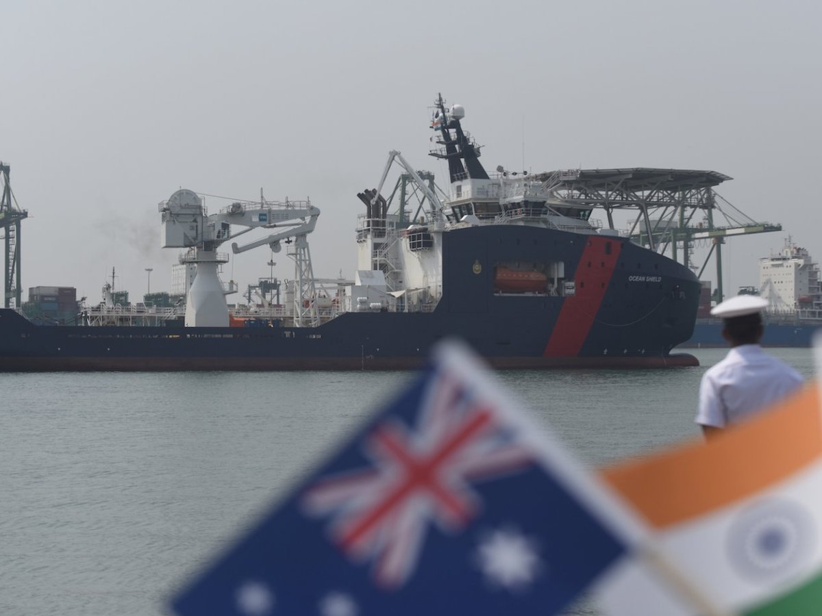 Indian coast guard personnel stand guard as Australian Border Force Cutter 'Ocean Shield' arrives at port in Chennai on May 18, 2017. Photo: AFP/Arun Sankar