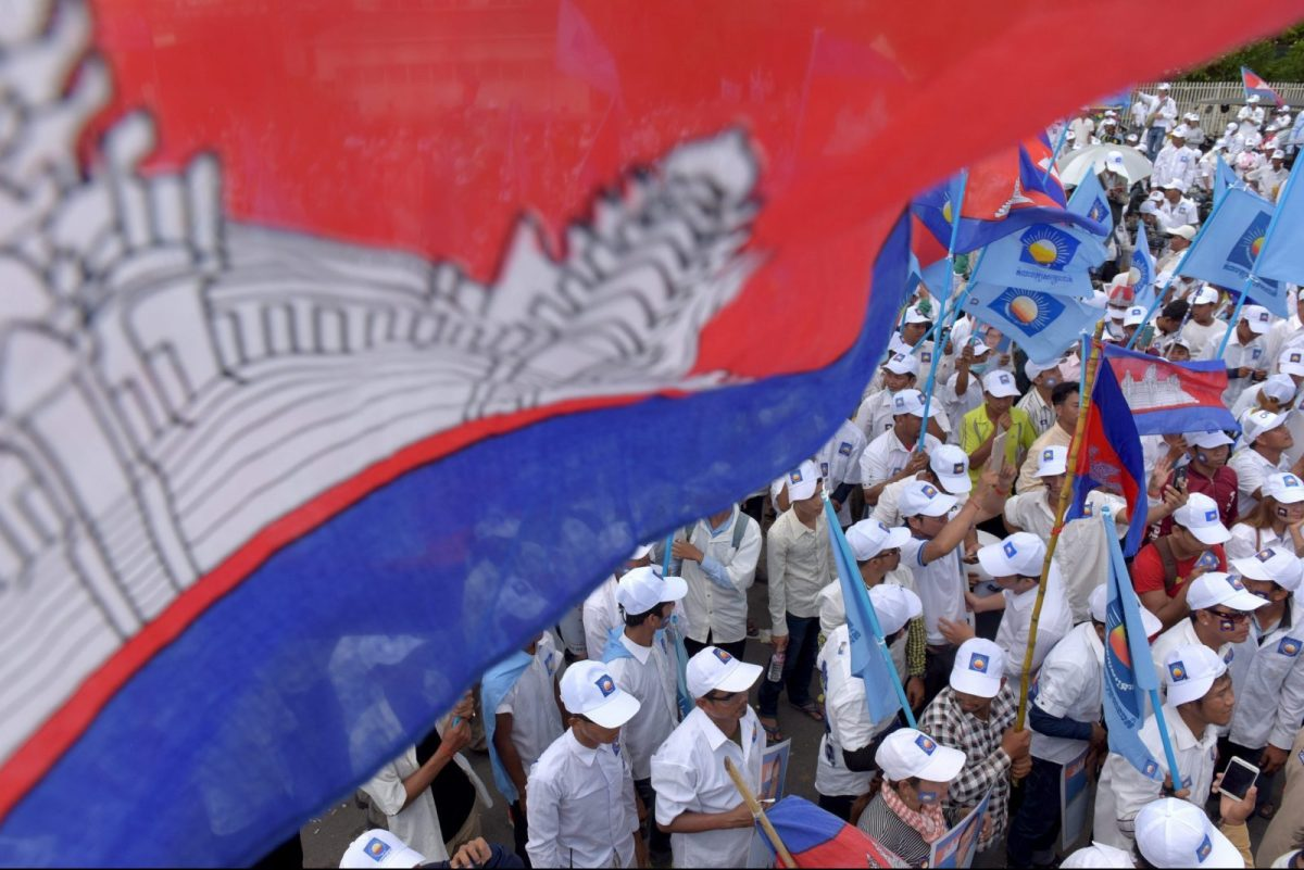 Supporters of Cambodia National Rescue Party (CNRP) gather in a rally on the last day of the commune election campaign in Phnom Penh on June 2, 2017.A sea of pro-government supporters rallied in the Cambodian capital in support of strongman PM Hun Sen on June 2, two days before local polls set to test the mettle of an opposition desperate to upend his 32-year rule. / AFP PHOTO / TANG CHHIN SOTHY